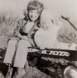 Sitting with my sister Barbara in our Radio Flyer